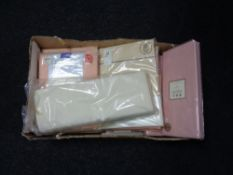 Two boxes of new sealed bedding and leopard print cushions