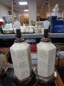 A pair of cream hexagonal pottery table lamps on wooden bases