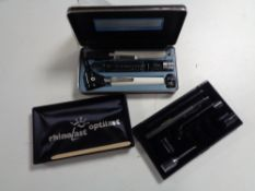 A Keeler Ophthalmoscope together with an Rhinolast oplist, both cased and bag of pieces.