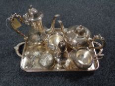 A plated twin handled gallery tray containing three decanter labels,