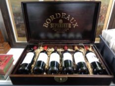 A wine casket containing six bottles of Bordeaux Superieur wine