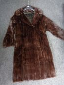 A mink fur 3/4 length coat