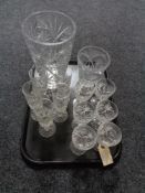 A tray of crystal champagne flutes and wine glasses,