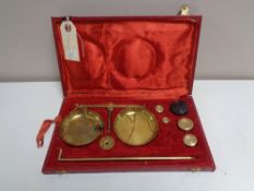 A set of vintage brass balance scales in fitted case