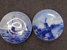 Two Delft plaques depicting fishing and windmill scene.