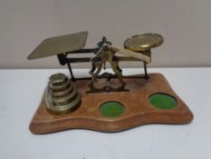 A set of twentieth century brass postal scales and weights
