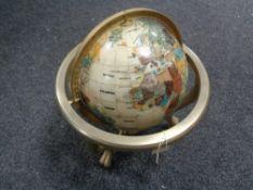A Gemstone globe on brass stand
