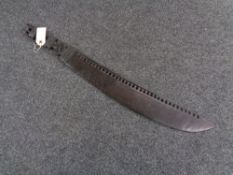 A carved tribal wooden machete