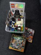 A box of lego and Star wars books