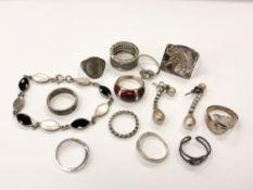 A silver bracelet,