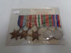 A set of five WW II medals on ribbons