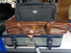 Two luggage cases together with a holdall of lady's handbags