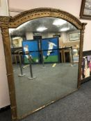 A large 19th century gilt framed mirror,