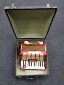 A Hohner Bjarne special accordion in carry case