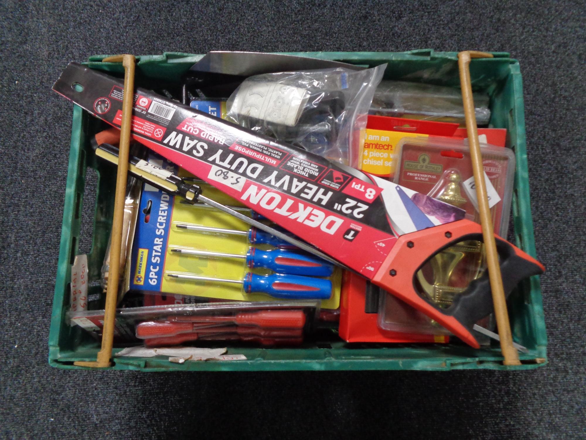 A crate of new tools, screw driver set, hand saw, brass door knocker,