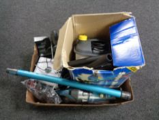 A box of wall paper steamer, cordless vac, charger,