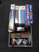 A box of board games, collector's plates,