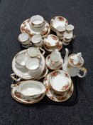 A collection of approximately sixty six pieces of Royal Albert Old Country Roses tea and dinner