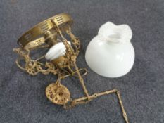 A Continental gilt metal hanging oil lamp with opaque glass resevoir (converted),