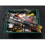A crate of new tools, bow saw blades, brick hammers,