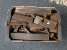 A box of vintage wooden wood planes