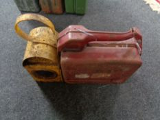 A metal railway lamp together with a jerry can