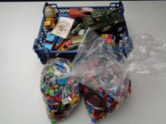 A box and crate of mixed Lego, die cast vehicles, Corgi, Matchbox,