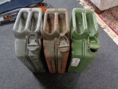 Three metal jerry cans