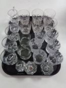 A tray of glass, crystal whisky glasses, candle holders,
