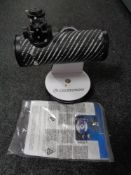 A Celestron 21024 bench top telescope with instructions and interchangeable lens
