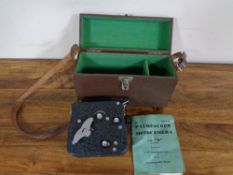 A leather cased Pathescope Motocamera type II cine camera with instruction book