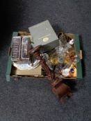 A box of miscellany to include wooden candlesticks, glass ware,