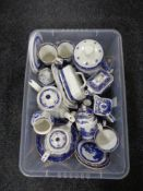 A box of Ringtons willow pattern china, tea services, storage jars,