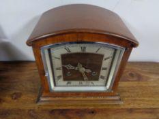 A 1930's mahogany mantel clock