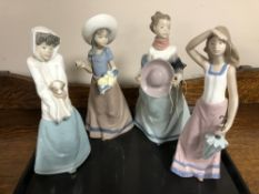 A tray of four Nao Four Seasons figures (a/f) CONDITION REPORT: One restored.