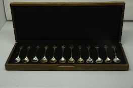 A set of twelve silver teaspoons issued by John Pinches for the Royal Society for the Protection of