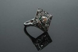 A white gold Art Deco style emerald and diamond ring,