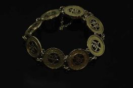 A 14ct gold Chinese panel bracelet, 14.8g.