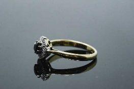 An 18ct gold diamond set sapphire ring, size Q.