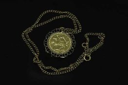A gold full sovereign - Isle of Man 1973, with pendant mount suspended upon a yellow metal chain.