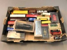 A collection of boxed and unboxed die cast vehicles including buses,
