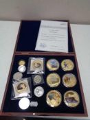 A case of fourteen assorted coins, gold plated James Cook collection with certificate, St.