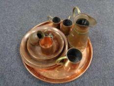 A collection of twentieth century copper ware, trays, bowls, measures,