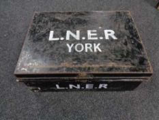 A metal deed box with hand painted writing L.N.E.R.