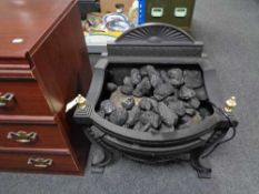 A gallery cast iron electric fire with coals