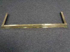 A brass extending fire curb