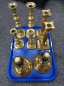 A tray of four pairs of brass candlesticks