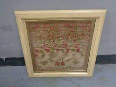 A nineteenth century framed alphabet sampler dated 1880