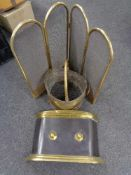 A brass four-way folding spark guard together with a brass fire front and coal bucket