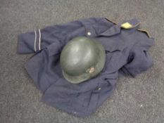 A WWII helmet with later decal and a German Air Force tunic